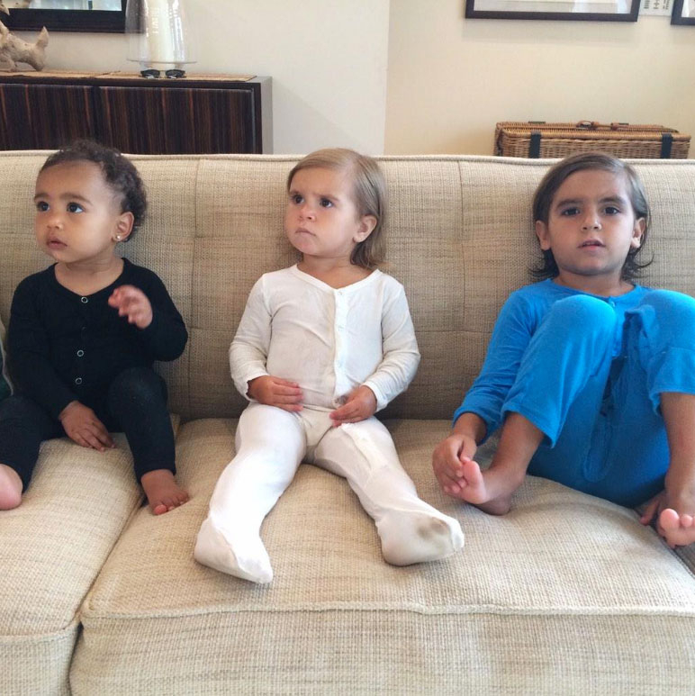 "Kim couldn't stop thinking of North, Penelope and Mason while traveling in November 2014. ""Missing these three sooooooo bad!!!!"" she captioned the pic of them sitting on a couch."