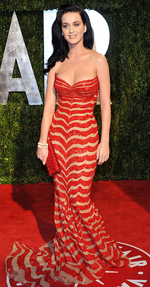 In a dazzling red and tan-striped Zuhair Murad Couture gown at the 2010 Vanity Fair Oscar Party in West Hollywood.
