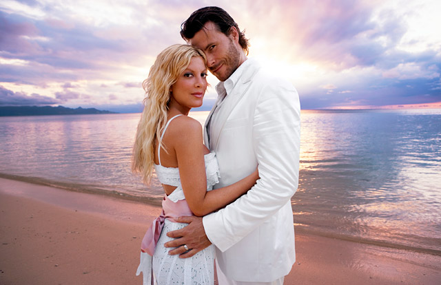Engaged since December 2005, the couple eloped to Fiji and tied the knot on May 7. Both barefoot for the non-denominational ceremony, Spelling and McDermott honeymooned on the island for nine days after their wedding.