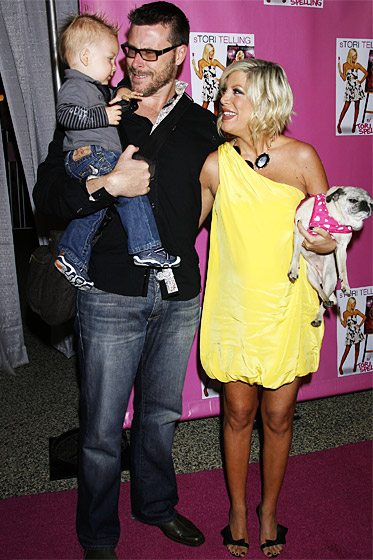 Shortly after his first birthday, baby Liam joined his mom and dad -- and the family's beloved pug, Mimi! -- for Spelling's book signing in Los Angeles.
