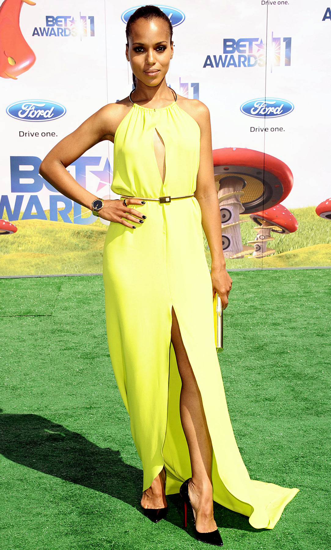 Walking the green carpet at L.A.'s Shrine Auditorium for the BET Awards, Washington stunned in a neon silk column dress with a silver neck ring from Michael Kors' 2012 Resort collection. Black Christian Louboutin pumps completed the edgy look.