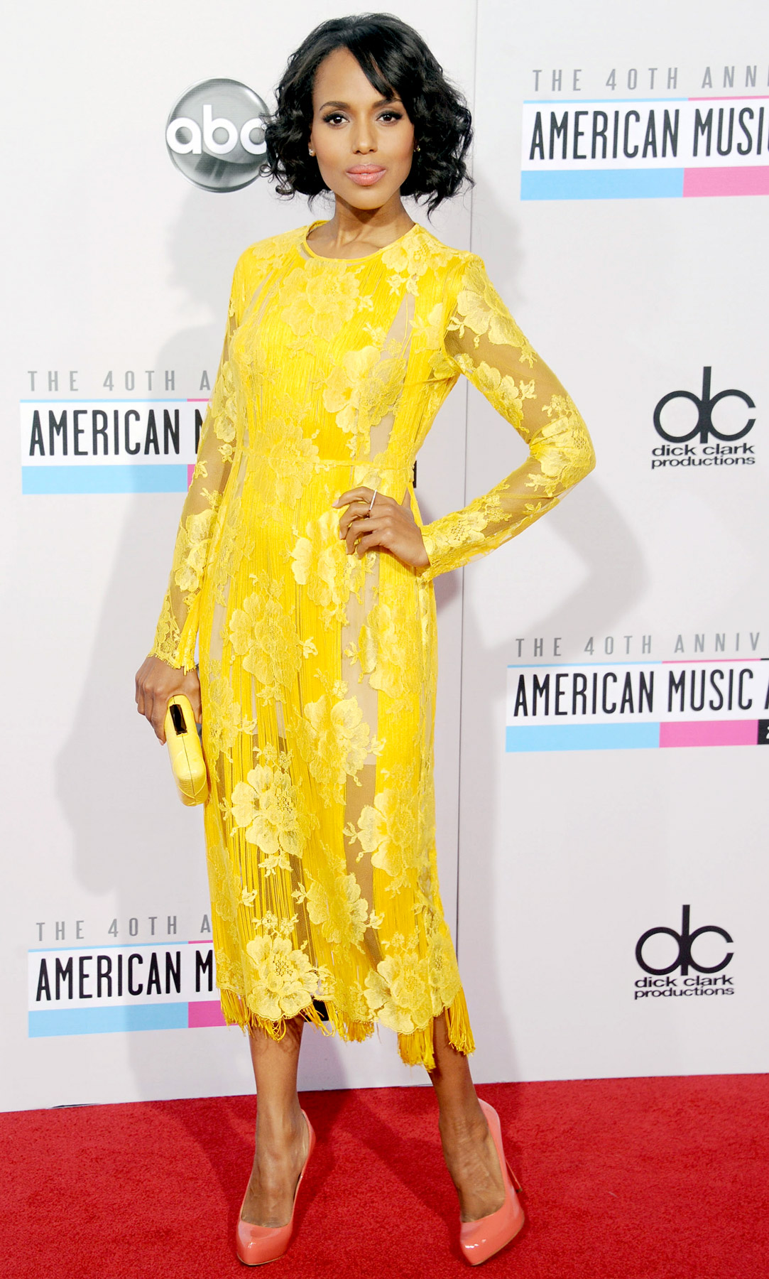 The actress looked fierce in a long-sleeved yellow Stella McCartney frock with fringe and lace detailing. She accessorized the look with coral Christian Louboutin pumps.