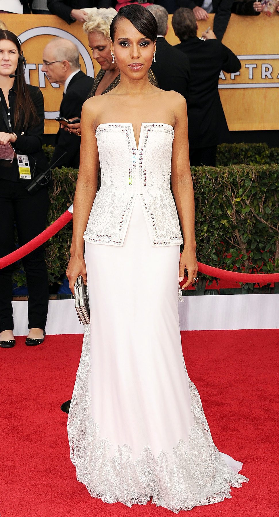 On the red carpet at L.A.'s Shrine Auditorium for the Screen Actors Guild Awards, Washington was the picture of modern elegance in a strapless white Rodarte gown with an embellished corseted bodice and a ruffled silvery lace hem.