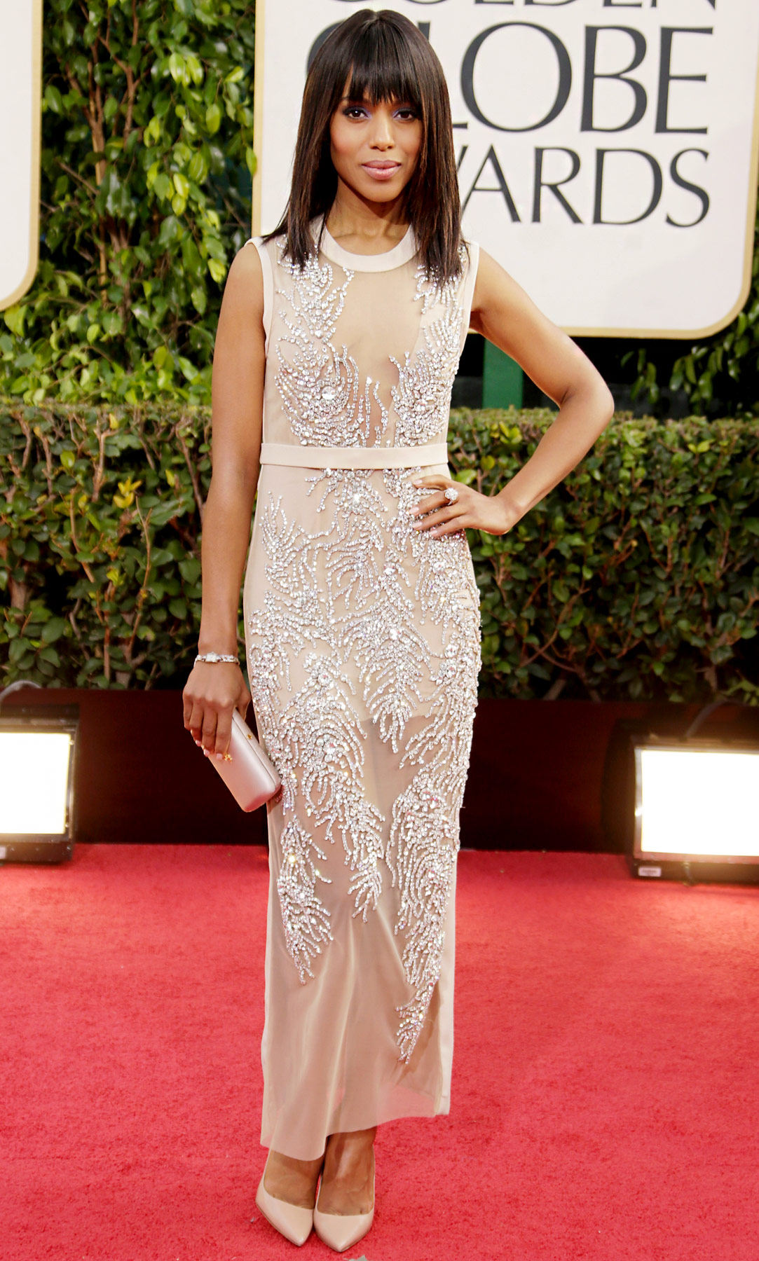 At the Golden Globes in Beverly Hills, the Django Unchained star stunned in a nude semi-sheer gown by Miu Miu with intricate all-over rhinestone beading. Nude Prada pumps, a satin clutch, and diamond jewelry completed the glam ensemble.