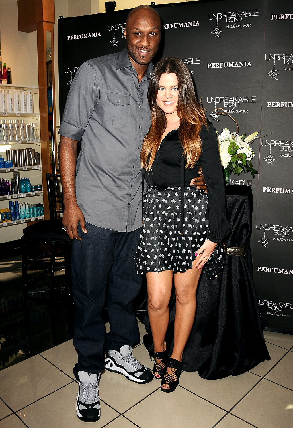 """Following their wedding in 2009, NBA basketball player Lamar Odom was always a constant support through her weight struggles. """"Lamar tells me he loves my body and I'm beautiful multiple times a day,"""" Khloé, pictured with Odom IN L.A. in 2012, has shared."""