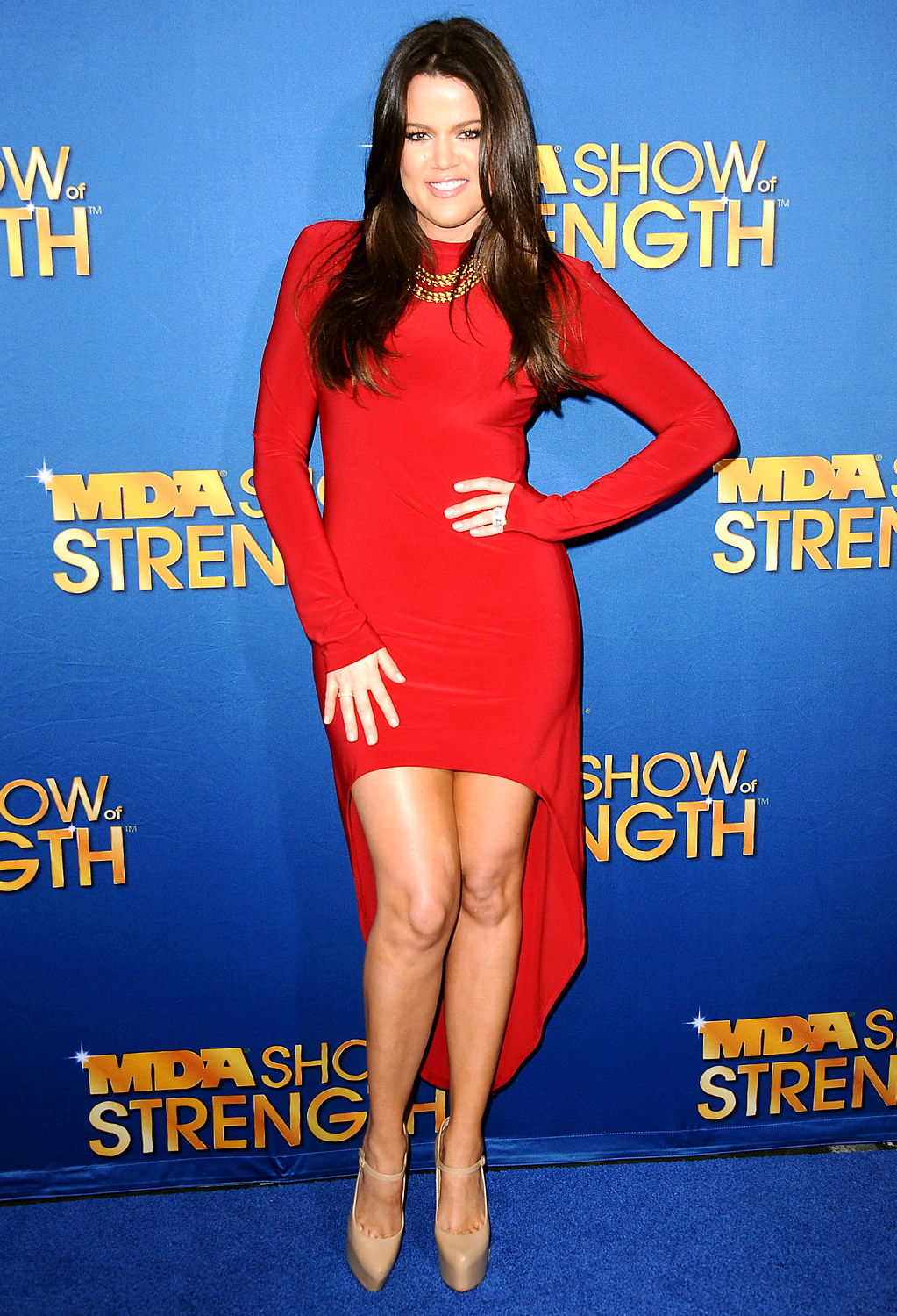 """By mid-2012, Khloé was feeling sexy enough to flaunt her curves in a leg-bearing red dress—haters be damned. """"I'm a size 6/8,"""" she told Us Weekly in the past."""