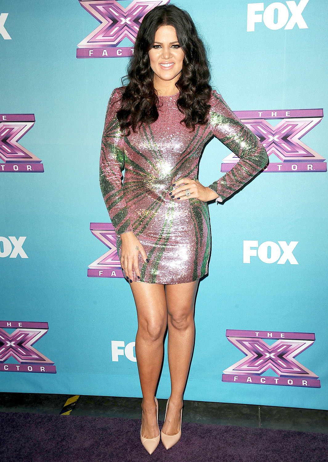 """Khloé noticeably shed pounds while she was hosting The X Factor in fall 2012 alongside Mario Lopez, thanks to boxing classes and changing her eating habits. """"I could have done a lot of unhealthy things to lose weight, and I'm proud for all the criticism I've taken and haven't done that,"""" she has said."""