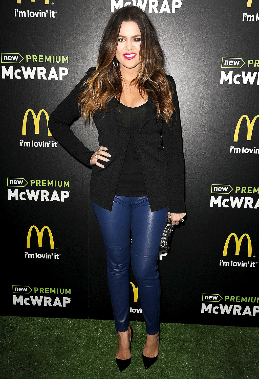 """Showing off her fit frame March 28, 2013 in a pair of blue leather jeans and a black blazer, Khloé told Us about her intense exercise sessions that she completes with a personal trainer. """"I love to box!"""" she said."""