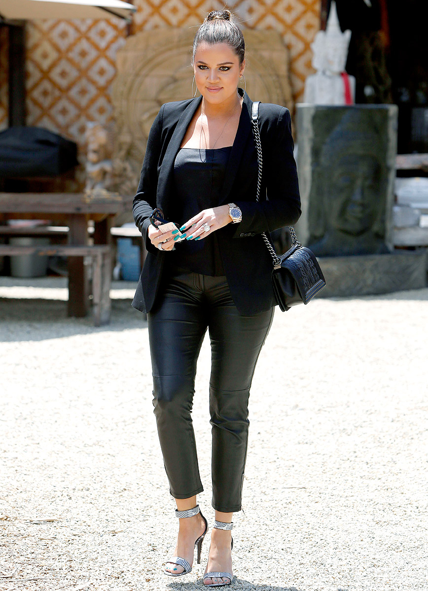 Khloé showed her rocking bod on June 25, 2013, wearing an all-black ensemble while attending an event. Wearing dark silver heels, black leather pants, a black tank and a black blazer, the star looked totally fierce—and is feeling more confident than ever.