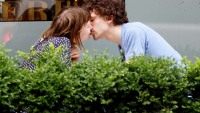 Mia Wasikoswka and Jesse Eisenberg kissed at a cafe in Toronto.
