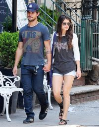 Taylor Lautner and Marie Avgeropoulos in New York on July 29, 2013