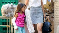 Katie Holmes and Suri wearing a cast in NYC on Sept 4, 2013