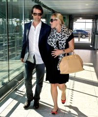 Pregnant Kate Winslet and Ned Rock 'n Roll depart Heathrow Airport