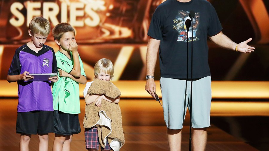 Will Ferrell and his children on stage at the 2013 Emmy Awards