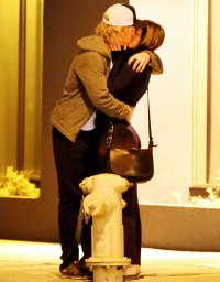 Owen Wilson and a woman kiss on October 7, 2013 in in Santa Monica