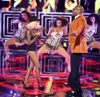 Christina Aguilera and Flo Rida perform on the Voice