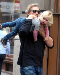 Eric Johnson and Maxwell walking around Soho in NYC on Dec. 5, 2013