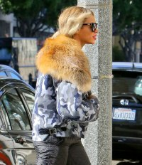 Beyonce stepped out in a fur lined coat while going vegan
