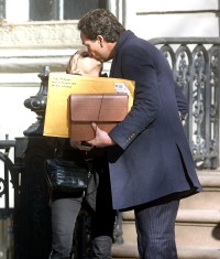 Mary-Kate Olsen and Olivier Sarkozy share a kiss in NYC on Dec. 12