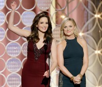 Tina Fey and Amy Poehler onstage at the 2014 Golden Globe Awards