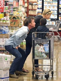 Sean Penn and Charlize Theron with her son Jackson at the store