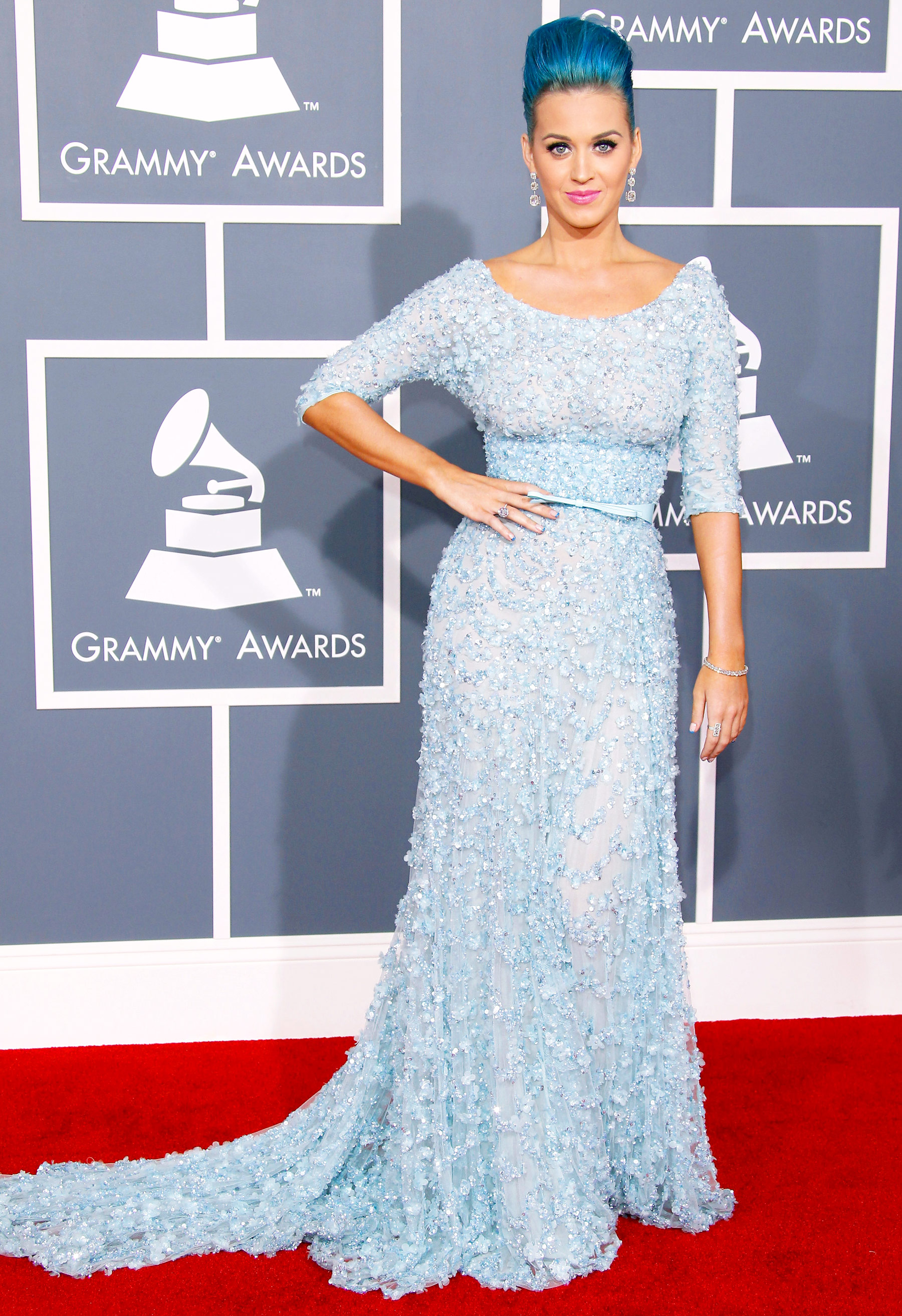 In a matchy-matchy blue Elie Saab gown and blue bouffant at the Grammys.