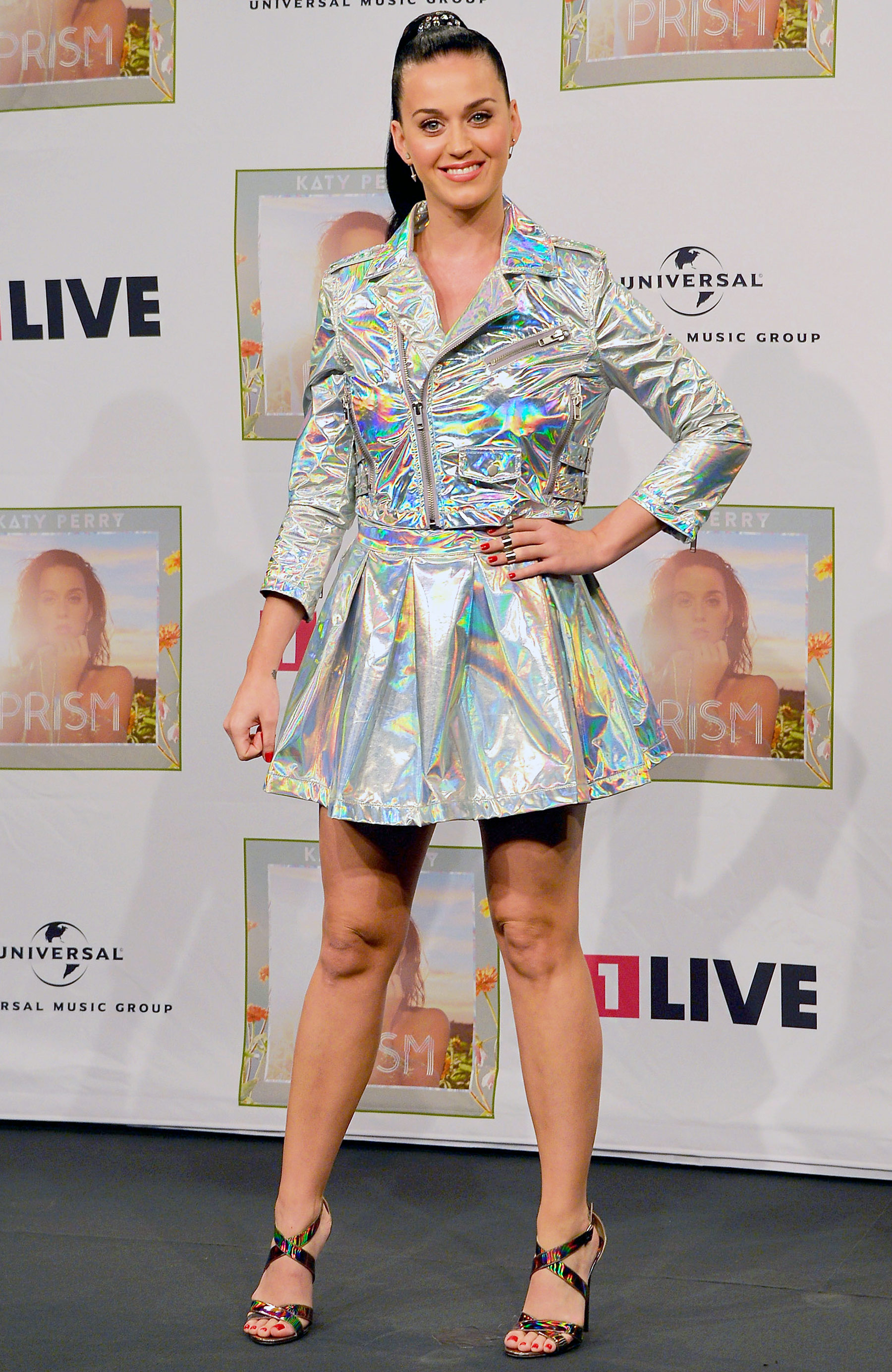 "Shining bright in a futuristic jacket-and-skirt combo while promoting ""Prism"" in Germany."