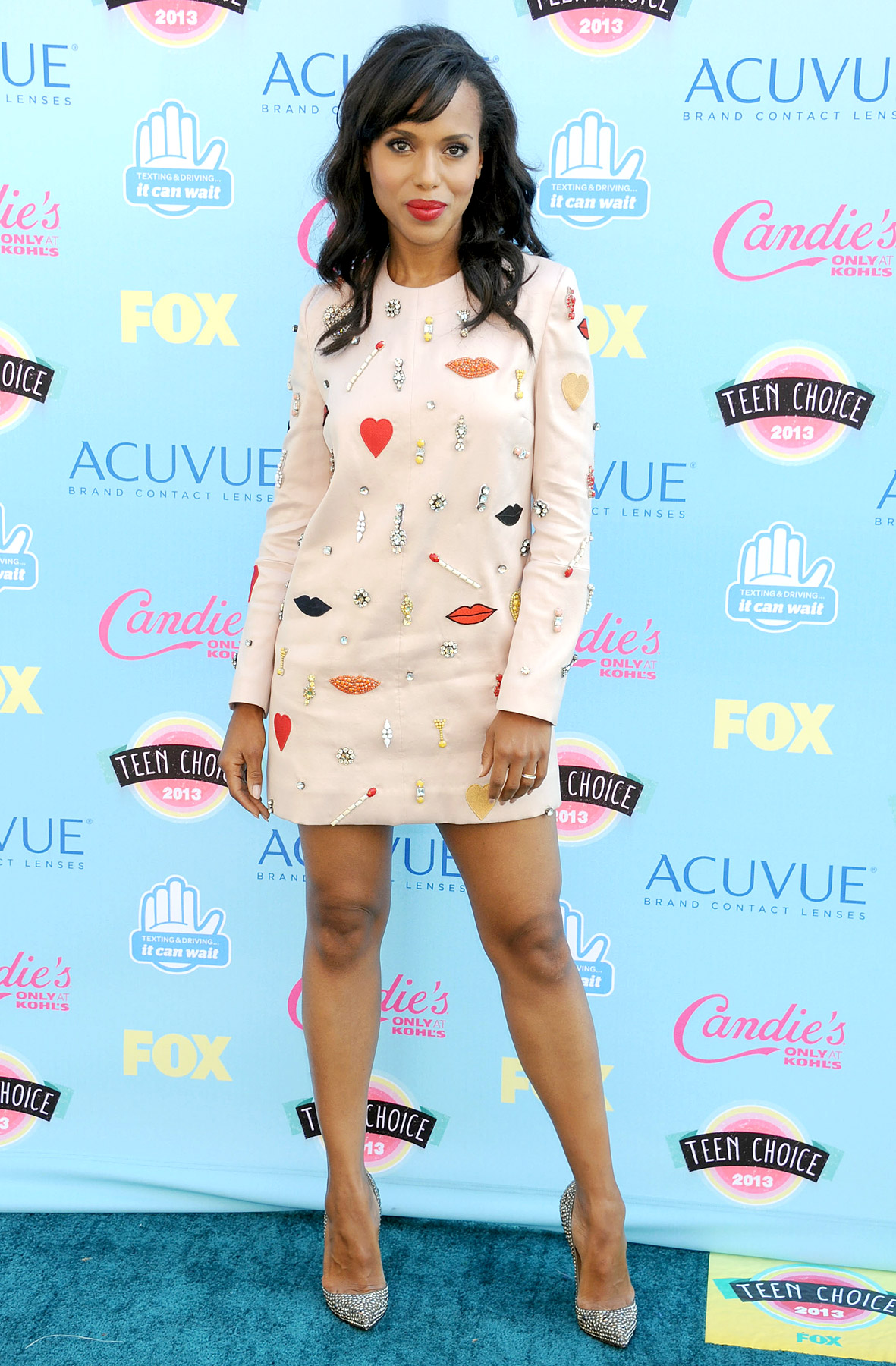 Lips, galore! Olivia Pope made a stylish entrance in a light pink Stella McCartney dress with lips and heart embellishments while attending the 2013 Teen Choice Awards in L.A. She also went for a bold red lip, and donned Christian Louboutin shoes and a Bottega Veneta bag.
