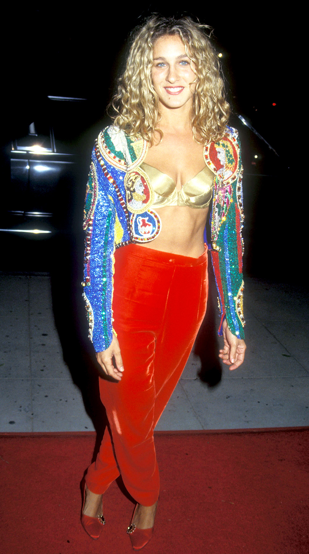 At the For the Boys Los Angeles premiere on Nov. 14, 1991, Parker amped up her sex appeal in a gold bra with red velour pants and an embellished jacket. Flashing her toned abs, she gave fans a sneak peek at her new sexy style.