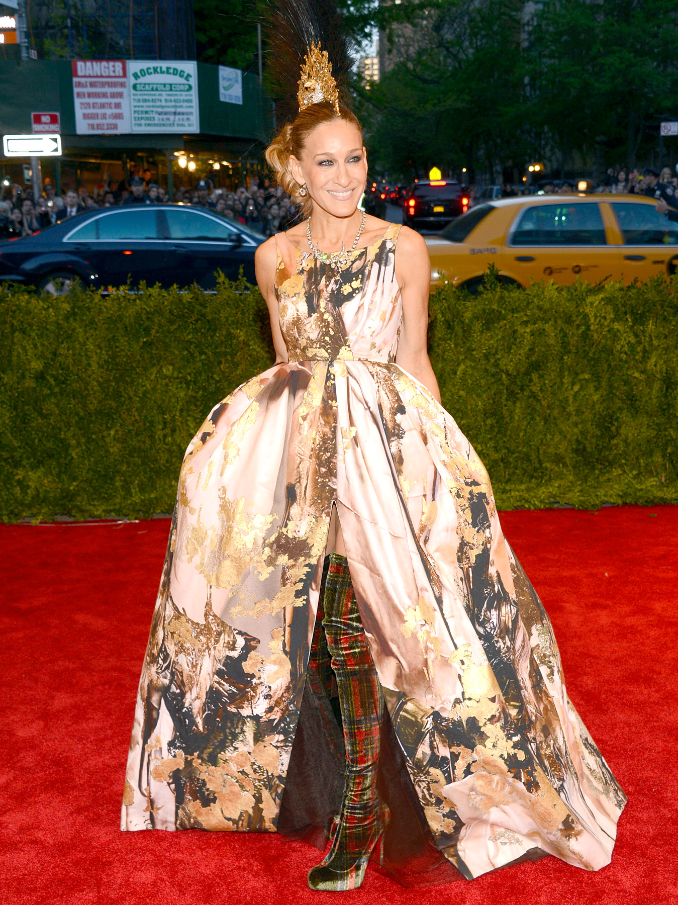 Though not everyone at the Met Gala on May 6, 2013, took the theme seriously, SJP showed she can make a statement and honor the event's theme in a punk-inspired ensemble. She wore a vibrantly printed Giles Deacon dress with Christian Louboutin plaid, thigh-high boots, but it was her Philip Treacy-designed mohawk headdress that received the most props as well as a pat from excited attendee Jennifer Lawrence .