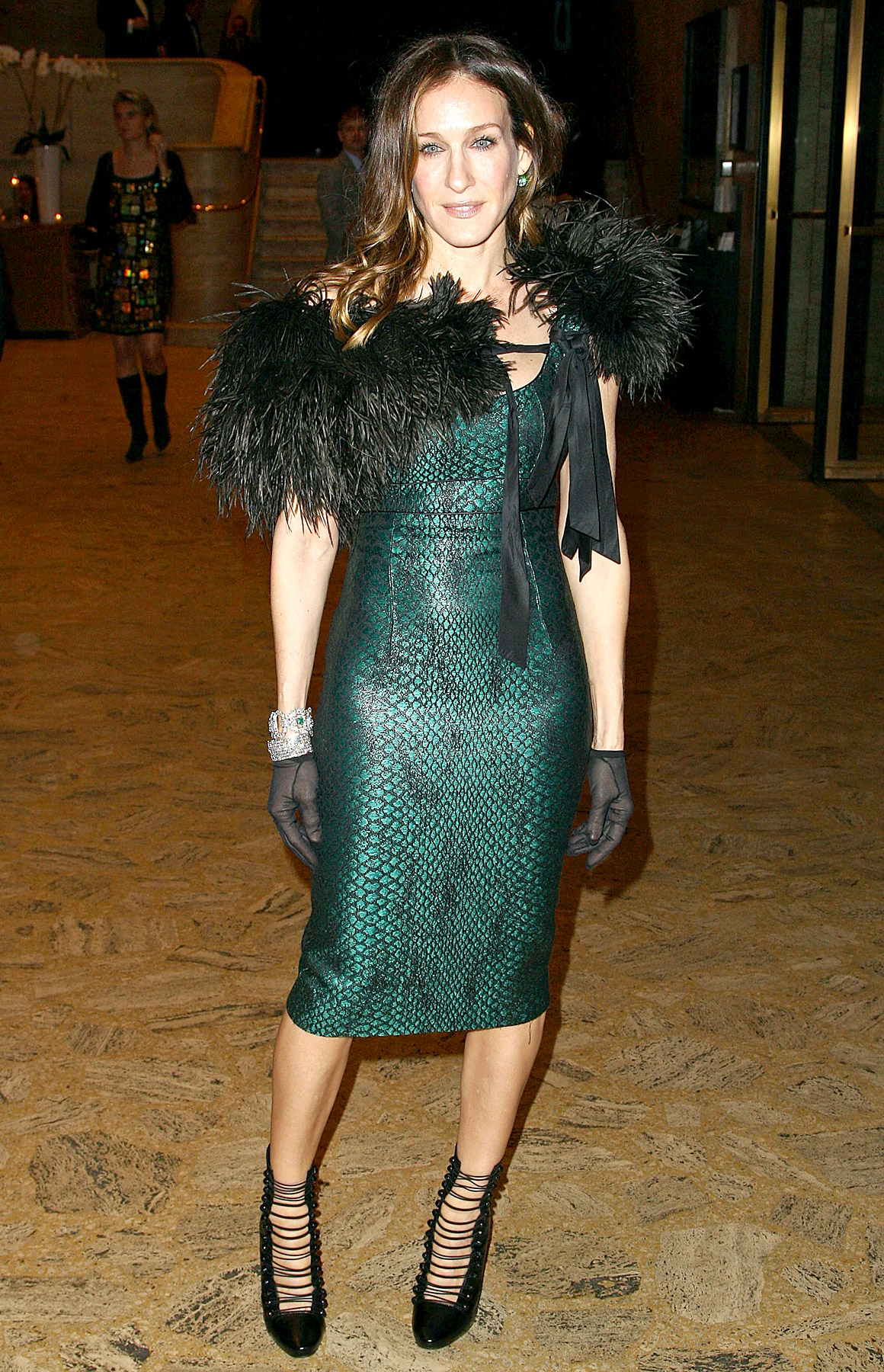 The mother of three went for an edgy emerald green, snakeskin L'Wren Scott dress with a black fur wrap and lace-up pumps at the School of American Ballet's winter ball on March 9, 2009.