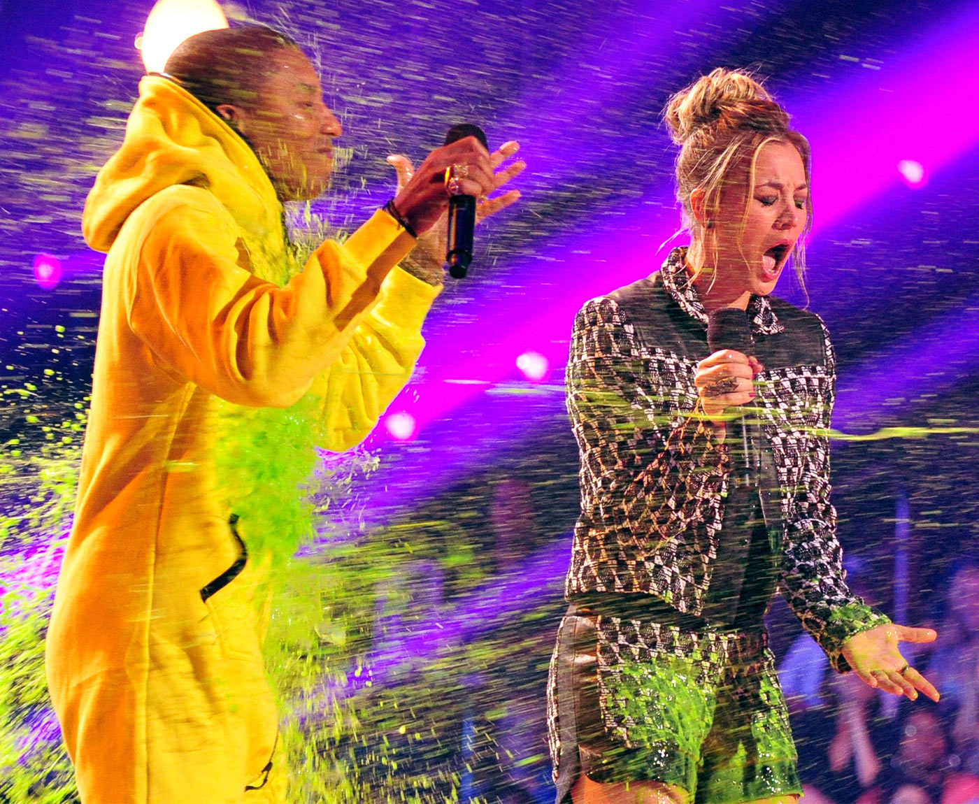 "Though the ""Happy"" singer came prepared in a yellow ""slime-proof"" jumpsuit, Big Bang Theory star Kaley Cuoco was caught off guard when she was hit with a stream of slime, mostly intended for Pharrell Williams."