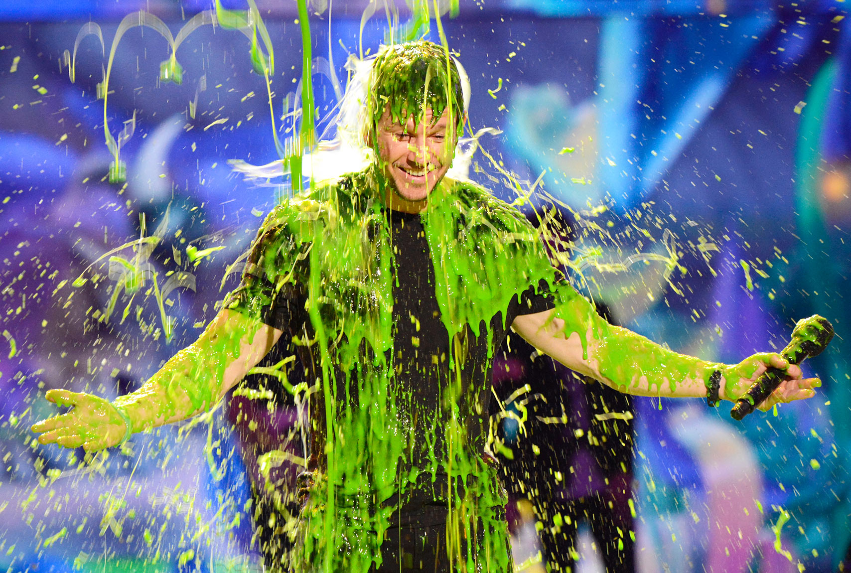 "After bragging on Twitter that he was ""#unslimable,"" Mark Wahlberg embraced the green splatter, crouching down to accept it on March 29. The host made it through the entire show before getting hit with the sticky shower."