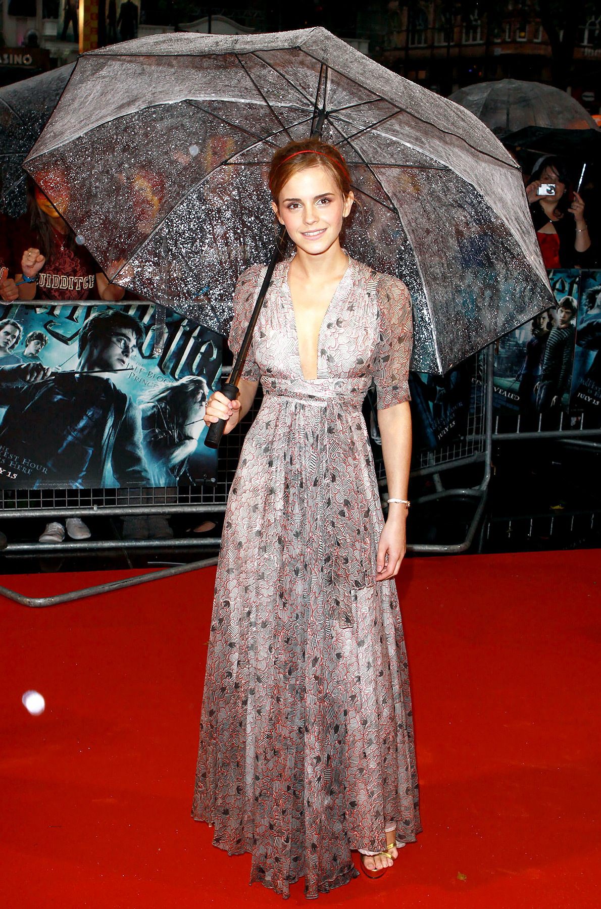 The actress braved the rain at the London premiere of Harry Potter and the Half-Blood Prince , still looking as put-together as ever with an umbrella in hand. The rising star went vintage for the occasion, wearing a sleeved wrap-waist dress from the 1970s which she told Vogue she found in a shop near her home.