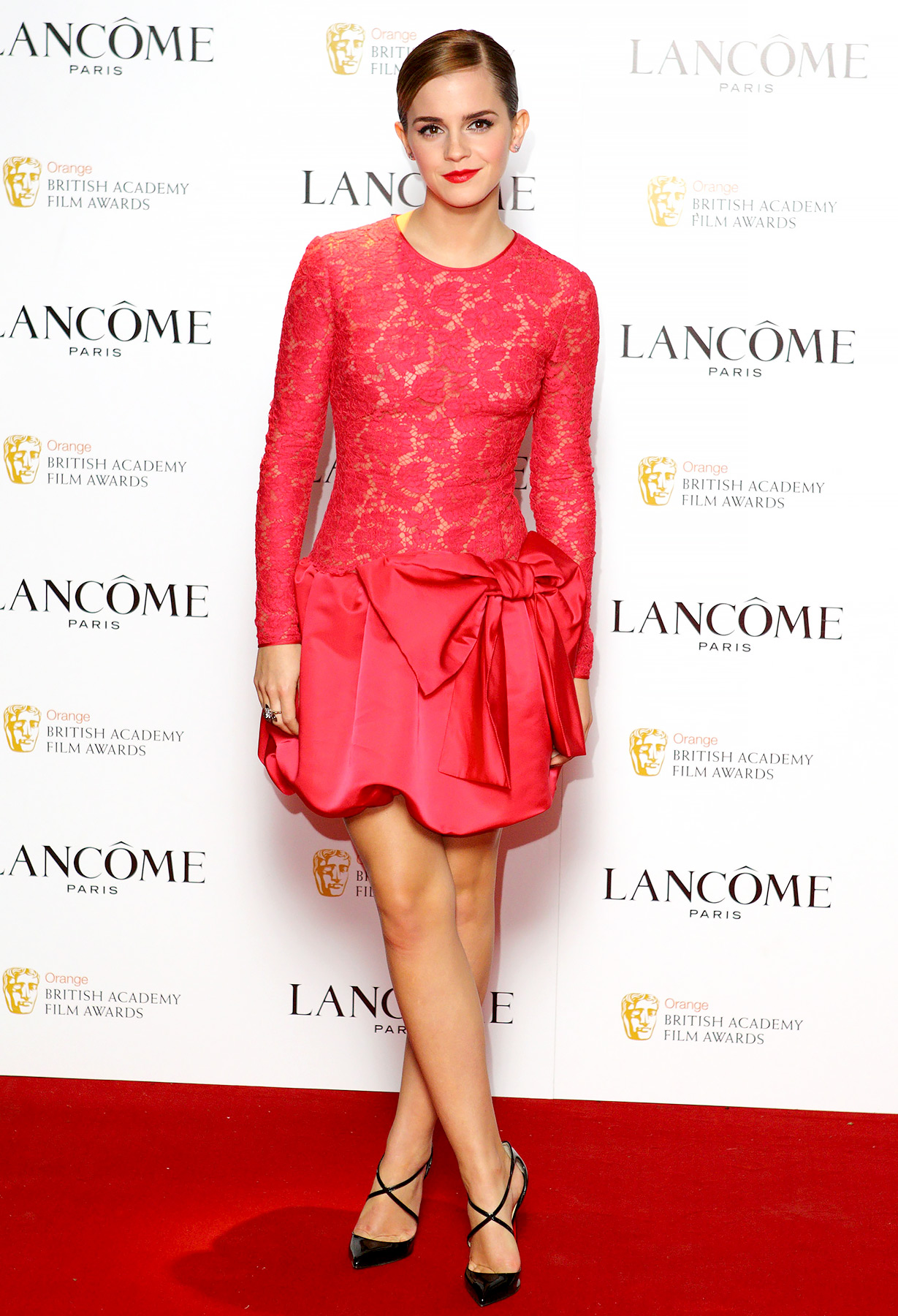 Exercising her style range, the British beauty went bold for a pre-BAFTA party hosted by Lancome in London. Post- Harry Potter , Watson showed her affinity for lace in a bright red Valentino dress, which featured a bubbled bow bottom.