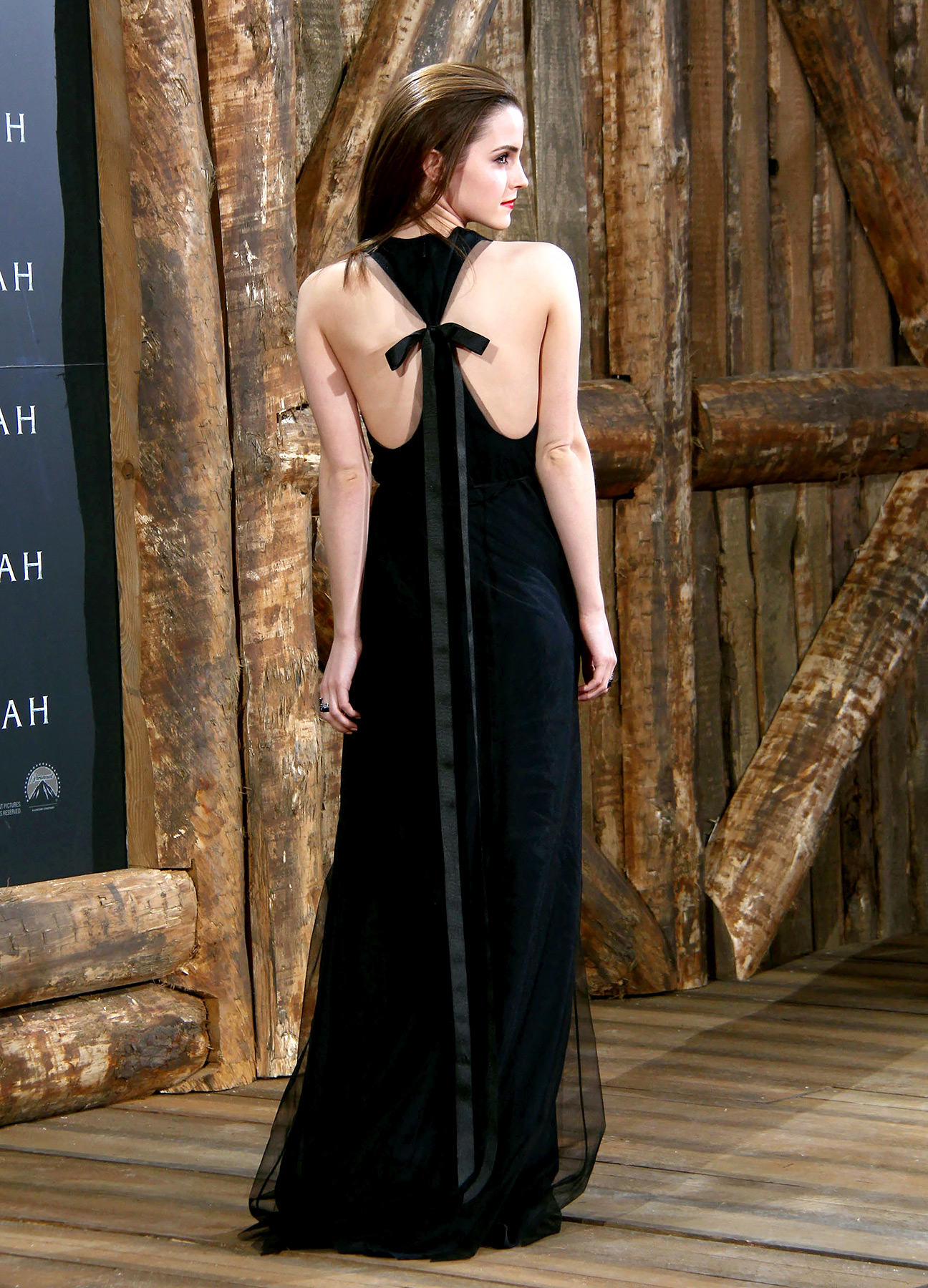 Watson kicked off the promotion for her flick Noah on a high note, rocking a Wes Gordon gown in Berlin. While the cinched-waist navy dress appeared simple from the front, Watson revealed a tied racerback with a floor-skimming bow.