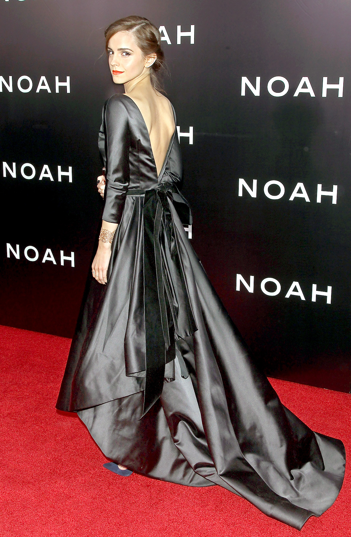 The Noah actress went dramatic for the New York premiere of her film, hitting the red carpet in an elegant Oscar de la Renta gown. The classy black satin number featured a boat neck and mid-length sleeves and showed off Watson's sexy side with a deep V-cut back, tied with a bow.