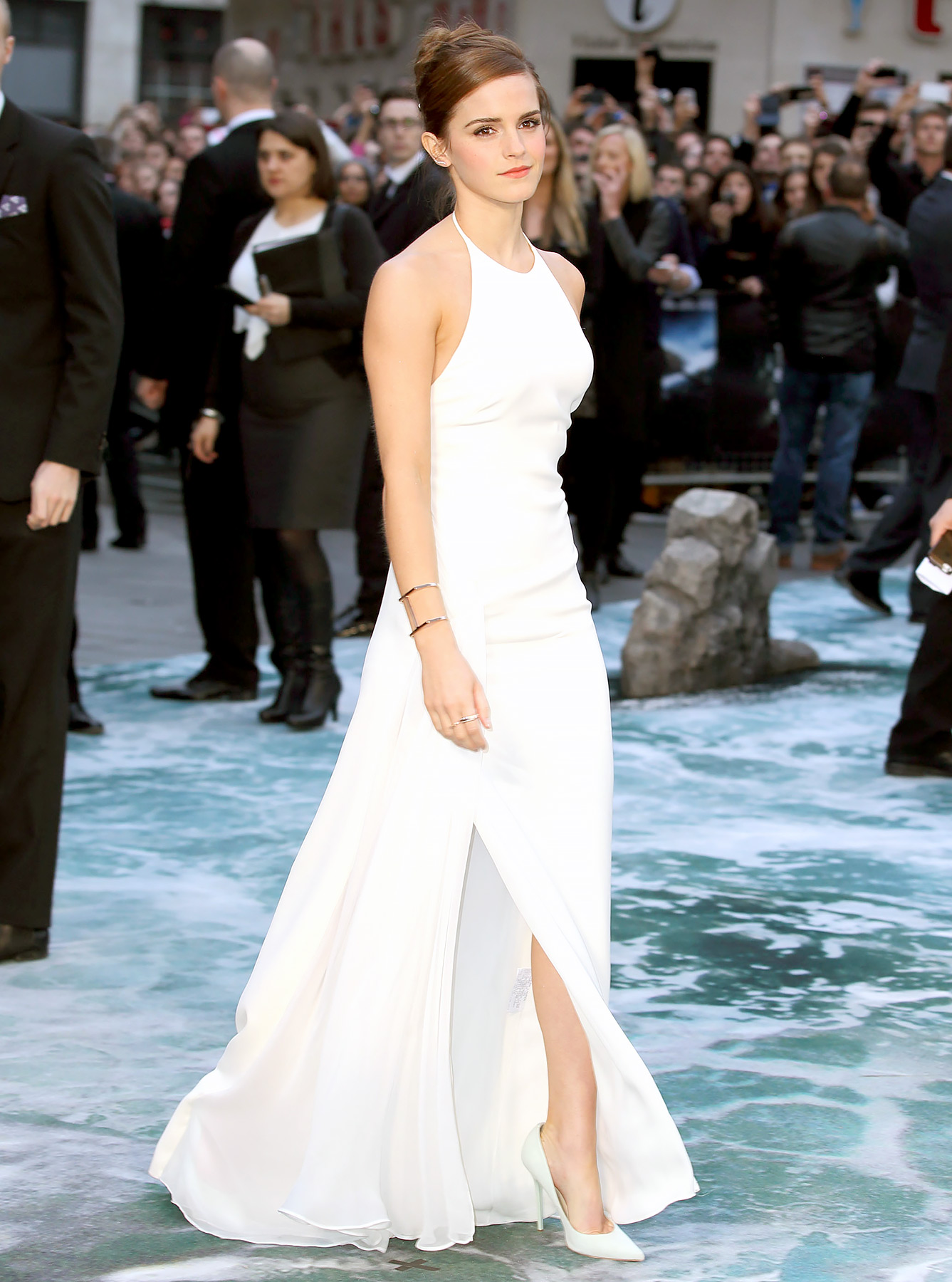 Emma Watson returned to white for the UK premiere of Noah , looking perfectly chic in a simple gown. The slim-fitting Ralph Lauren Collection dress showed off the actress' gams with a thigh slit and her shoulders with a high halter neck.
