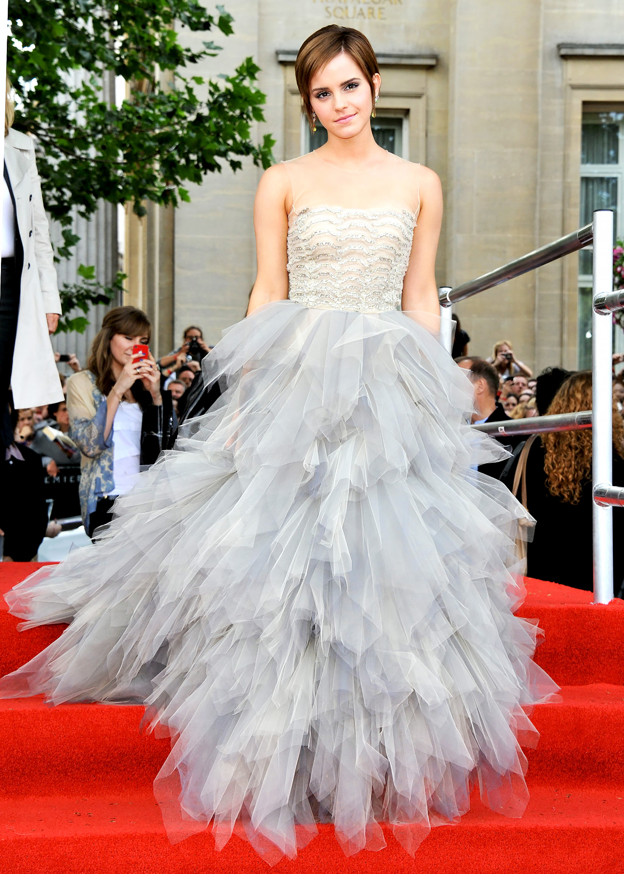 Emma Watson celebrated her final run as Hermione at the world premiere of Harry Potter and the Deathly Hallows: Part 2 in London . 21 years old at the time, Watson wore a stunning Oscar de la Renta dress for the occasion.