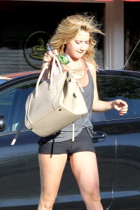 Ashley Tisdale carries a Celine tote as she heads to the gym