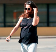 Mila Kunis displays her baby bump as she leaves a yoga class on May 1
