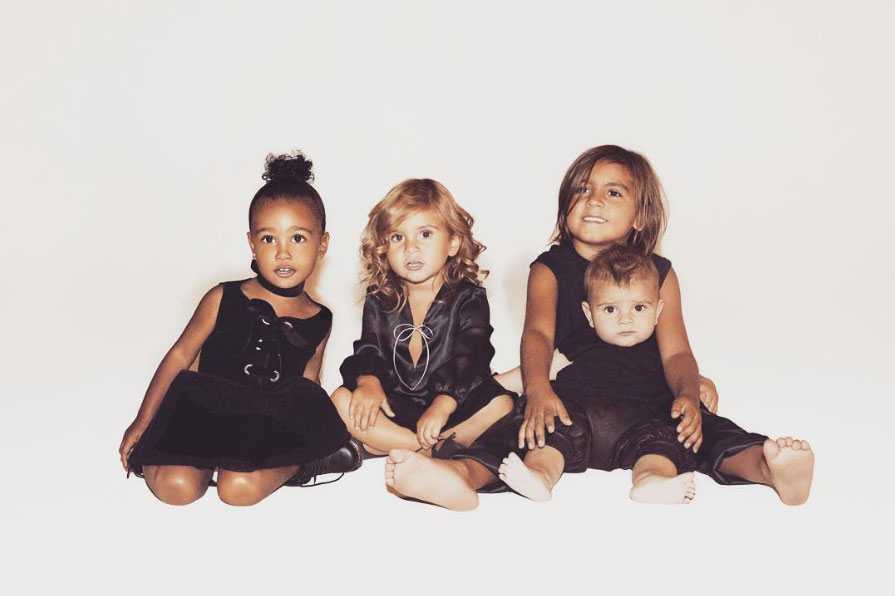"North, Penelope, Mason and Reign coordinated in black for an adorable pic in December 2015. ""CHRISTMAS CARD 2015: ALL YOU NEED IS LOVE,"" Kim captioned the fridge-worthy Instagram photo."