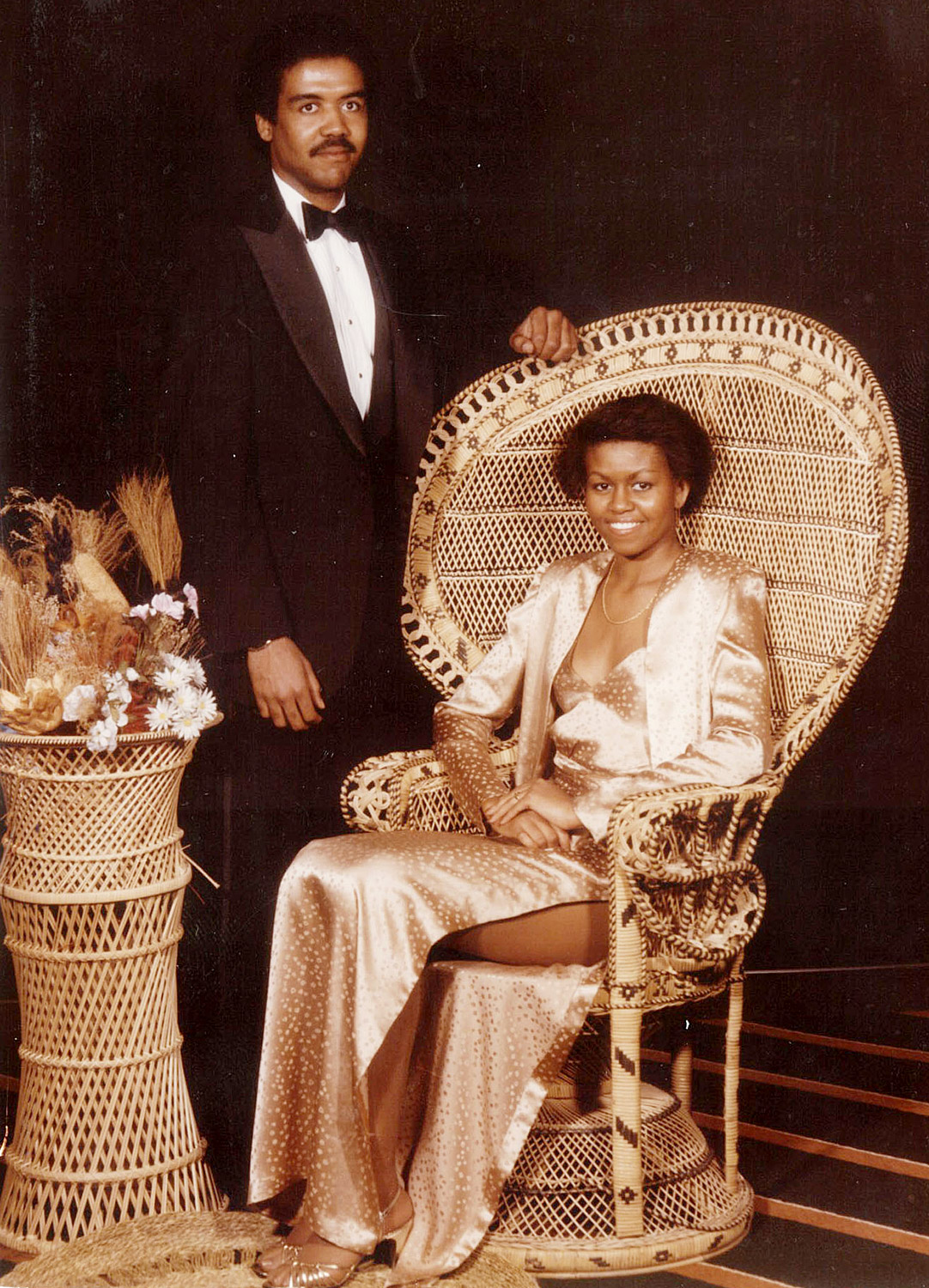 "The First Lady was always regal, even taking her place upon a groovy throne for her prom portrait with her first boyfriend David Upchurch at Chicago's Whitney M. Young High School in 1981. She admitted to Ellen DeGeneres that her dress was a little too revealing: ""That split was a little high. I don't know if i'd let my kids go out with a split that high."""