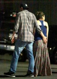 Ashton Kutcher puts hand on Mila Kunis' butt on May 18, 2014
