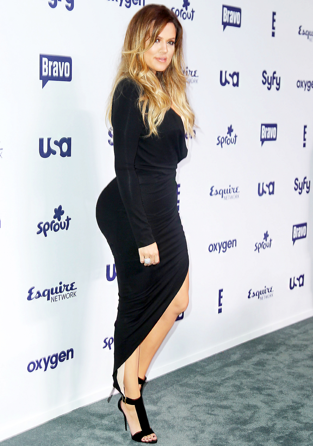 """Khloé, here, at the NBC Universal Upfronts in NYC in May 2013, is open about the hard work that goes into maintaining her healthy figure, regularly sharing photos of her workouts. """"I hate not being consistent in the gym,"""" she captioned a pair of photos of herself lifting weights in May 2014."""
