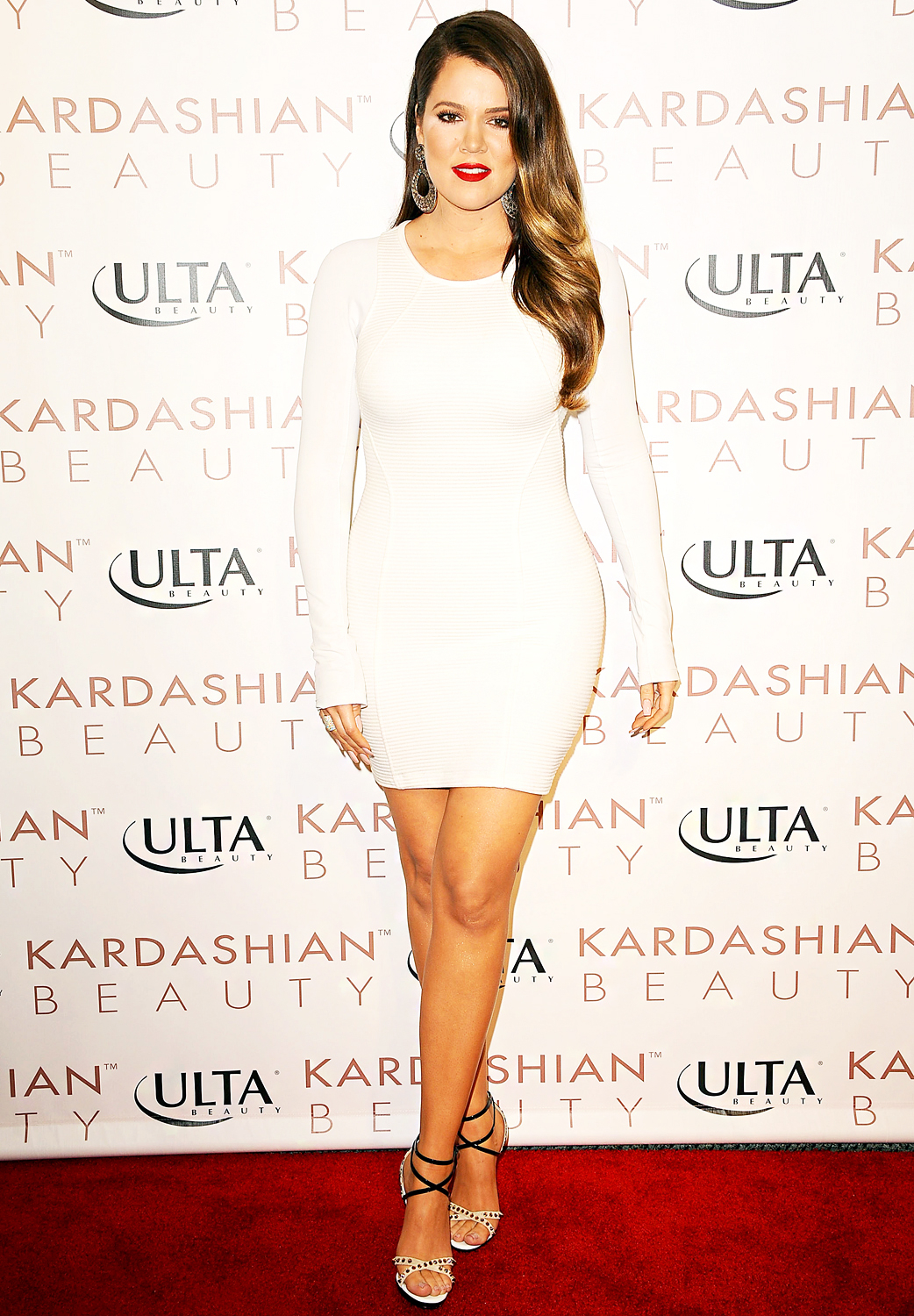Flaunting her toned legs in a tight white dress in June 9, 2013, the star shined on the red carpet.