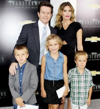 Mark Wahlberg and Rhea Durham pose on the red carpet with their kids