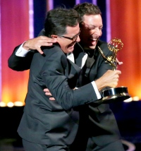 Stephen Colbert and Jimmy Fallon on stage during the 66th Emmy Awards