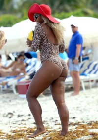 Serena Williams plays football on the beach in Miami