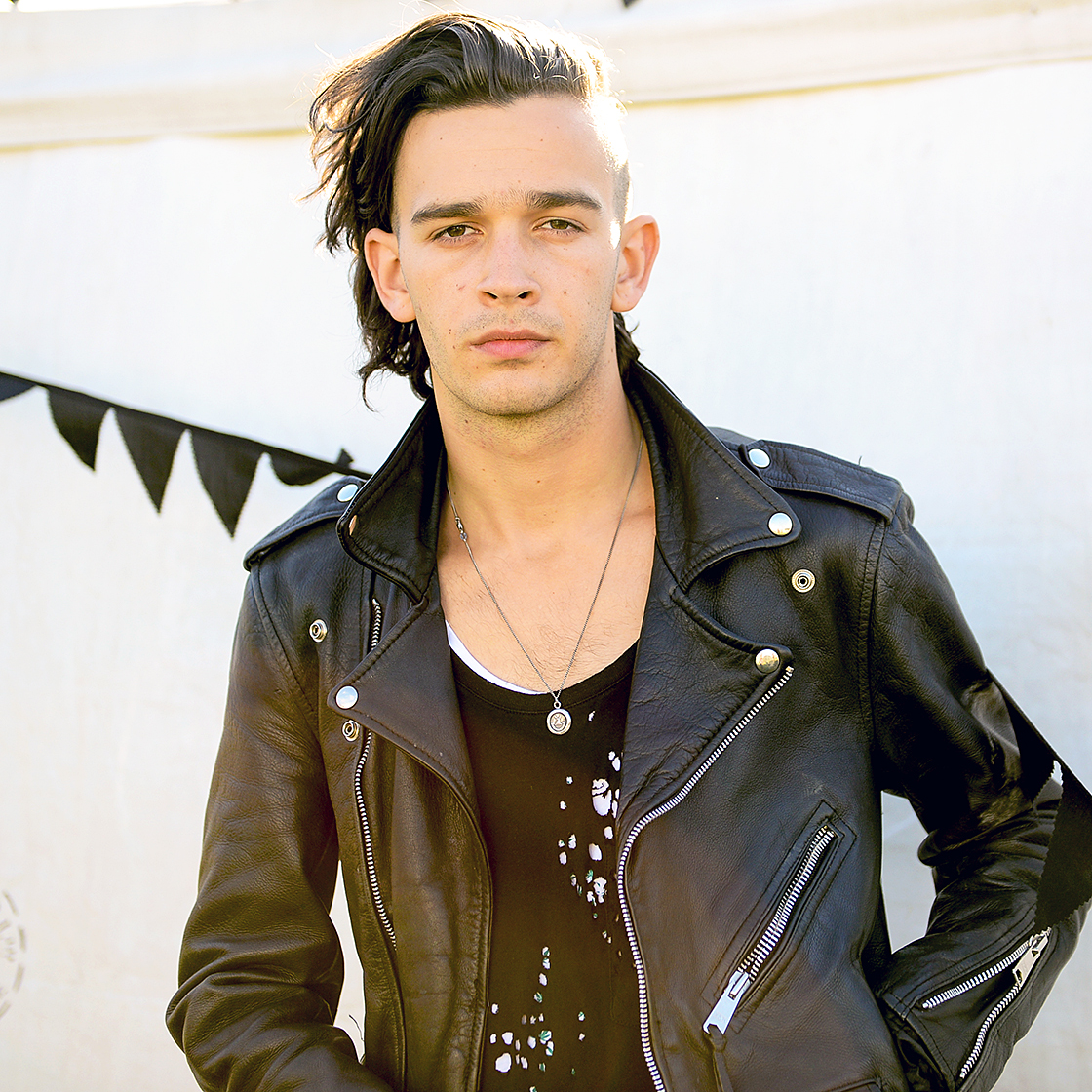 Sources exclusively revealed to Us that Swift spent time with The 1975's Matt Healy in late 2014. Swift met Healy backstage at one of his band's concerts, and the two hit it off.